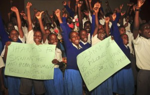 AP Photo by Stephen Wandera showing children in Uganda holding placards supporting the Anti-Homosexuality Bill and President Yoweri Museveni