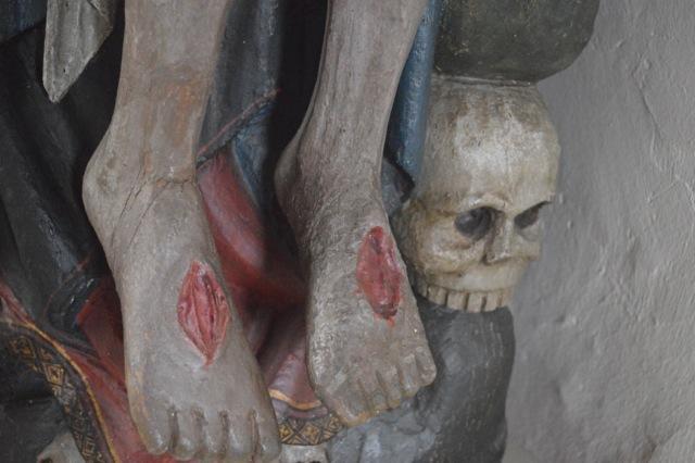 Genomstungna fötter och den gamle Adams skalle