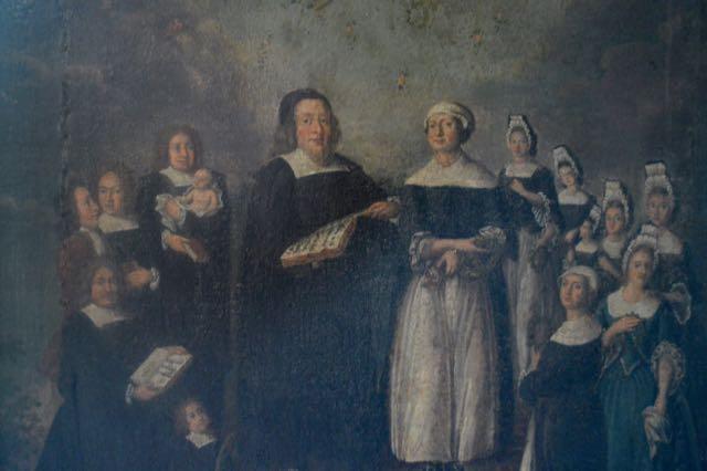 Stor prästfamilj på tavla längst ner i kyrkan.