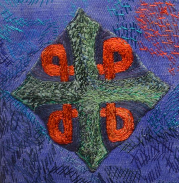 Pilgrimssymbolen broderad